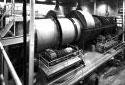 Écorceuse à tambour à l'atelier de préparation du bois à l'usine Fraser d'Edmundston